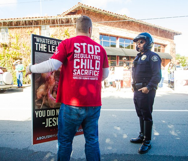 """PUSHBACK A local man protests against Planned Parenthood in SLO in February 2017. This year, Planned Parenthood said it could no longer offer health care services at a North County clinic after a nonprofit it partnered with ended the relationship due to receiving """"hostile communications"""" from anti-Planned Parenthood activists. - FILE PHOTO BY JAYSON MELLOM"""