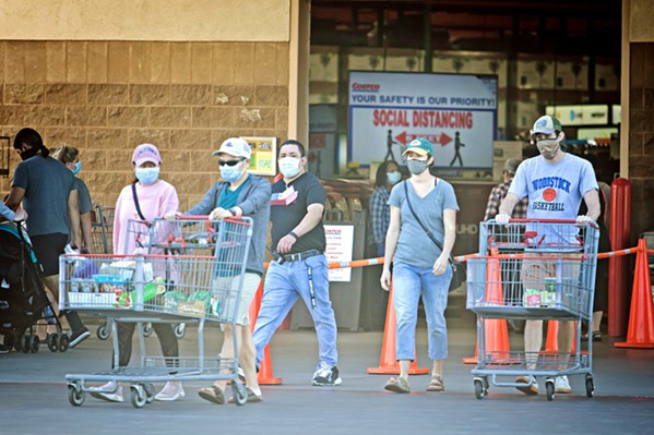 IN CHARGE Ordinances in SLO County mandate face coverings in grocery stores, but employees are left to enforce the rule. - FILE PHOTO BY JAYSON MELLOM