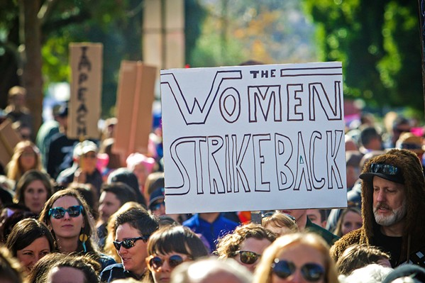 EQUAL RIGHTS Locals march in San Luis Obispo during the inaugural Women's March in 2017. - FILE PHOTO BY JAYSON MELLOM