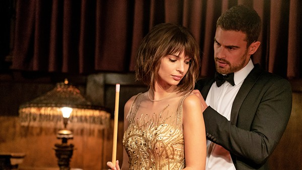 KINDRED SPIRITS Elyse (Emily Ratajkowski) meets Ivan (Theo James) at a party, where he's there to steal artwork and she's working a con, and they develop an uneasy pact, in the crime drama Lying and Stealing, available on HBO and Amazon Prime. - PHOTO COURTESY OF 50 DEGREES ENTERTAINMENT