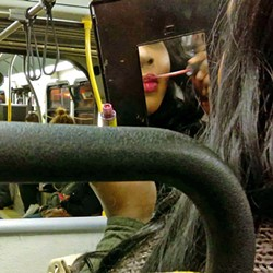 LABIOS Poet and photographer Marisela Norte's images capture the fashion and colors of the Latino community, such as a woman applying lip gloss while in transit. - PHOTOS COURTESY OF STUDIOS ON THE PARK