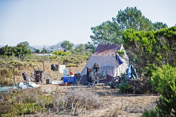 MOVE ALONG A small homeless encampment near the Los Osos library will be cleared out by the county this month. - PHOTO BY JAYSON MELLOM