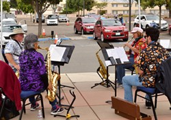 SAFELY GROOVING Active Aging Week participants were able to safely step out of their cars and dance to a live saxophone quartet on Oct. 8 in Santa Maria. - PHOTO COURTESY OF RANDY DE LA PENA