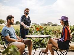 RESERVE FOR A TASTE Slide into one of Castoro Cellars' outdoor tasting tables over Harvest Wine Weekend for a barrel tasting. - PHOTO COURTESY OF CASTORO CELLARS
