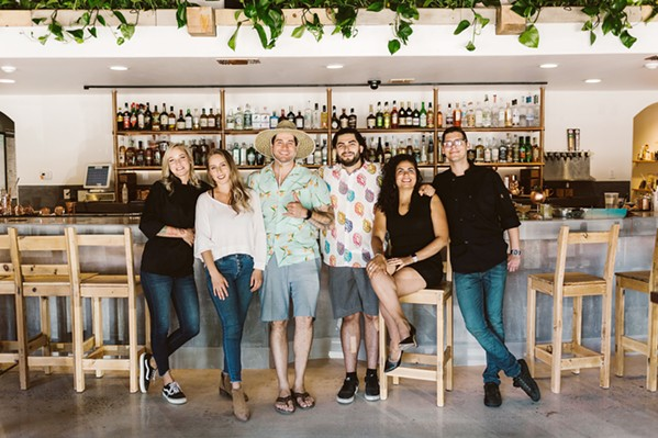 TIGHT-KNIT Opened by a group of friends, The Alchemists' Garden team is close and collaborative. From left to right: Chef Danelle Jarzynski; co-owners Quin Cody, Tony Bennett, Andrew Brune, Alexandra Pellot; and Travis Hallanan. - COURTESY PHOTO BY SARAH KATHLEEN PHOTOGRAPHY