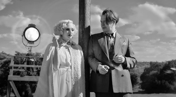 FROM HOLLYWOOD TO HEARST CASTLE Screenwriter Herman J. Mankiewicz (Gary Oldman) develops a friendship with William Randolph Hearst's mistress, Marion Davies (Amanda Seyfried), in director David Fincher's Mank, now streaming on Netflix. - PHOTO COURTESY OF NETFLIX