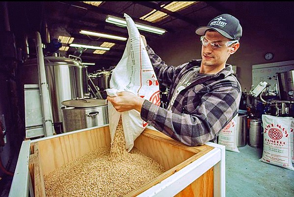 GRAIN FOR MASH Colony Mash Brewing Co. owner/brewer Erik Knapp gets the grain ready to go into the kettle. - PHOTOS COURTESY OF COLONY MASH BREWING CO. INSTAGRAM