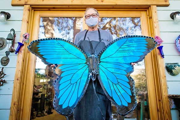 WINGED BEAUTY Artist Larry Le Brane shows off his latest butterfly creation as part of the Veterans Voices' Wings of Change installation. - PHOTO BY JAYSON MELLOM