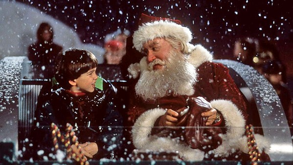 SANTA'S SLAYER Scott Calvin (Tim Allen, right) takes his son, Charlie (Eric Lloyd, left), out for a sleigh ride, roughly one year after they witnessed Santa Claus die in front of them, in Disney's The Santa Clause. - PHOTO COURTESY OF DISNEY