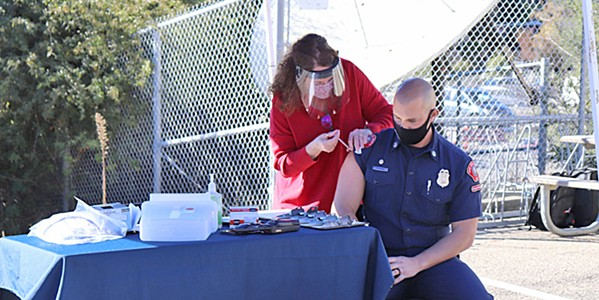 PROTECTION SLO city paramedic Alec Flatos was one of the first locals to receive the COVID-19 vaccine on Dec. 18. - PHOTO COURTESY OF SLO COUNTY PUBLIC HEALTH