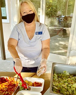 CHIPPING IN El Camino Homeless Organization (ECHO) volunteer Wendy Johnson serves dinner to clients in Atascadero on Jan. 7. ECHO is looking for more community volunteers to help with its expansion to Paso Robles. - PHOTO COURTESY OF WENDY LEWIS