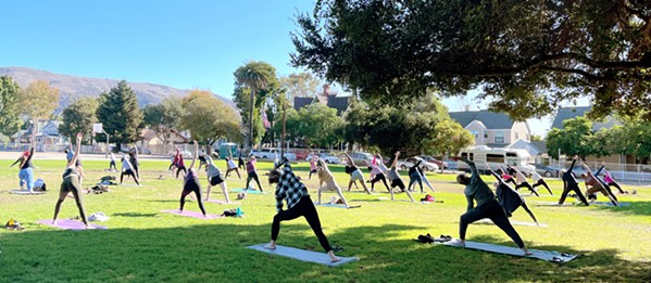 GRATITUDE Each Sunday, SLO Yoga Center hosts an outdoor yoga class in the park. Its Thanksgiving weekend class (pictured) drew a big turnout in Emerson Park. - PHOTO COURTESY OF STEPHANIE STACKHOUSE