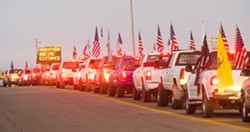 READY TO RIDE Trucks line up outside the entry to the Oceano Dunes SVRA on Oct. 30, 2020, the first day in seven months that vehicles were allowed in the park. - FILE PHOTO BY JAYSON MELLOM