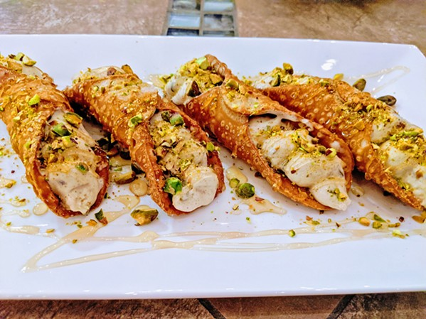 DELICIOUS Although fried cannoli isn't traditionally Persian, the Middle Eastern flavors of the ice cream Shekamoo Grill squeezes inside them go perfectly with the crunchy shell, pistachios, and honey. - PHOTOS COURTESY OF SINA SHAKERIAN
