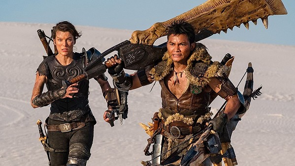 MONSTER MASH After being transported to a hidden realm, Capt. Artemis (Milla Jovovich, left) teams with Hunter (Tony Jaa) to fight giant monsters, in the video game adaptation Monster Hunter, available at Redbox. - PHOTO COURTESY OF CONSTANTIN FILM