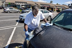 RETURN TO MOBILE A new ordinance passed by Santa Maria City Council aims to make mobile car washers truly mobile by banning washing on public property. - FILE PHOTO BY CAMILLIA LANHAM