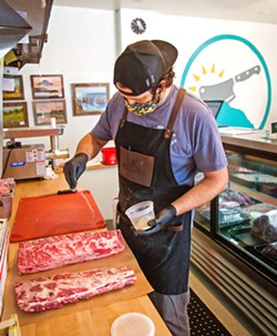 SEASONED Butcher Geoff Montgomery gets tri-tip ready for roasting at Morro Bay's new butcher shop. - PHOTOS BY JAYSON MELLOM