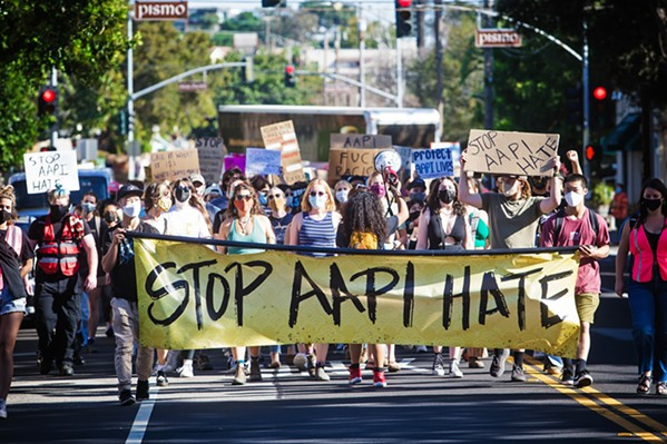 """COMMUNITY Stop the AAPI (Asian American Pacific Isander) Hate rally attendees chanted, """"this is what community looks like"""" as they marched through SLO city's downtown area. - PHOTO BY JAYSOM MELLOM"""