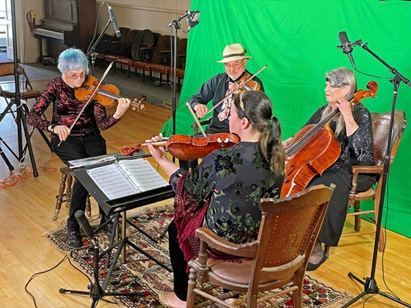 MAKING VIDEO MAGIC The Candlelight Strings—(clockwise from left) Bette Byers, Christopher Reutinger, Jeanne Shumway, and Mary Beth Rhodes-Woodruff—are shown recording videos of songs from Ragtime Musicale: Music For Silent Films, available on cdbaby.com. - PHOTO BY GLEN STARKEY
