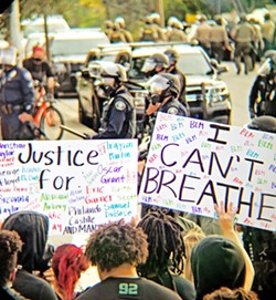 TOUGH YEAR The SLO Police Department will discuss its 2020 crime report, including its response to protests (pictured), on May 4. - FILE PHOTO BY PETER JOHNSON