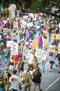 DEFUND Cal Poly SQE is one of several groups in SLO County pushing for divestment from policing. - FILE PHOTO BY JAYSON MELLOM