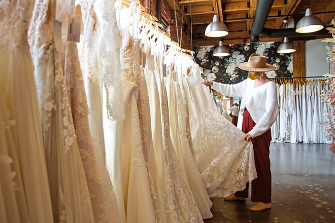 DREAM DRESS Moondance Bridal Manager Olivia Pereira can help brides-to-be with tough decisions about length, cut, material, fit, and more at the Best Bridal Shop, located on Santa Barbara Avenue in San Luis Obispo. - PHOTO BY JAYSON MELLOM