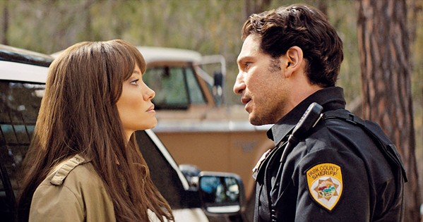 FIRED UP Former smokejumper Hannah Faber (Angelina Jolie) argues with her ex, Deputy Sheriff Ethan Sawyer (Jon Bernthal), in Those Who Wish Me Dead, screening at most local theaters and on HBO Max. - PHOTO COURTESY OF BRON STUDIOS