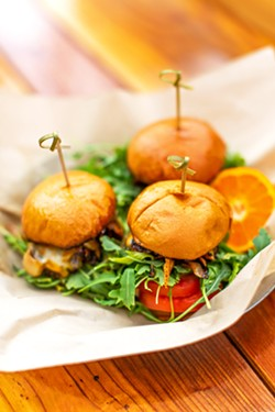 FLAVOR BOMBS Lobo's sliders contain chorizo and beef patties served with grilled onions, tomatoes, arugula, and Beerwood aioli on a brioche bun. - COURTESY PHOTOS BY CADY CONNELLY