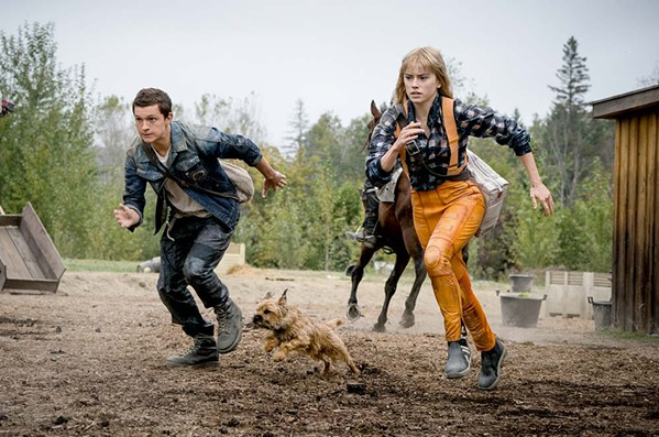 RUN FOR IT Todd (Tom Holland), Viola (Daisy Ridley), and an adorable little dog run from a band of misogynists, in Chaos Walking, a sci-fi action film that recently arrived at Redbox. - PHOTO COURTESY OF 3 ARTS ENTERTAINMENT