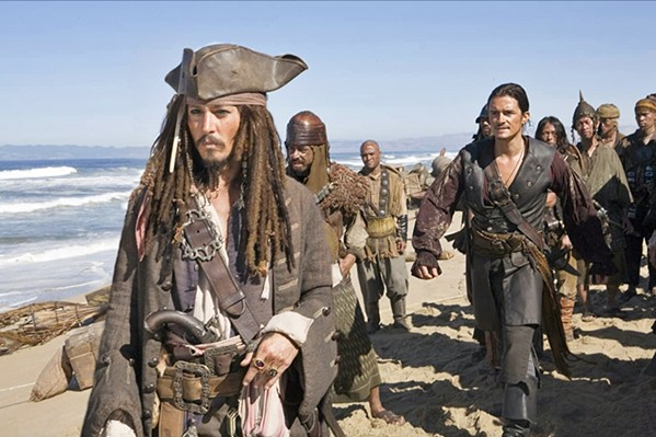 THE WORLD'S END Johnny Depp and Orlando Bloom appear in The Pirates of the Caribbean: At World's End (2007), partly filmed at the Guadalupe-Nipomo Dunes. - COURTESY PHOTO BY STEPHEN VAUGHN FROM DISNEY ENTERPRISES INC.