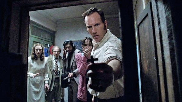 THE POWER OF CHRIST COMPELS YOU Ed Warren (Patrick Wilson) uses his trusty cross to clear the way, in the middling horror threequel The Conjuring: The Devil Made Me Do It. - PHOTO COURTESY OF NEW LINE CINEMA