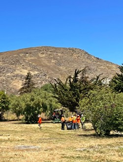 CLEANING UP Crews finish a cleanup of a homeless encampment off the interchange of Highway 101 and Madonna Road in SLO on June 10. - PHOTO BY PETER JOHNSON
