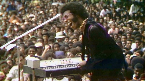 'TAKE YOU HIGHER' Sly Stone entertains a huge crowd during the Harlem Cultural Festival, which took place over six weekends in 1969, in the new documentary Summer of Soul, screening at The Palm Theatre and on Hulu. - PHOTO COURTESY OF CONCORDIA STUDIO AND SEARCHLIGHT PICTURES