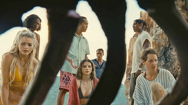 GOING ... GONE Various vacationers at a tropical resort discover their lives have sped up on a secluded beach, aging years every hour, in auteur M. Night Shyamalan's Old, playing in local theaters. - PHOTO COURTESY OF UNIVERSAL PICTURES