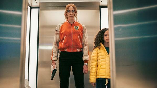 KILLER ELITE Female assassin Sam (Karen Gillan, left) has to retrieve kidnaped Emily (Chloe Coleman), in the female-centric shoot-'em-up Gunpowder Milkshake on Netflix. - PHOTO COURTESY OF STUDIOCANAL AND THE PICTURE COMPANY