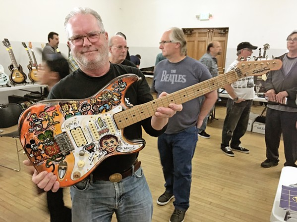 CALLING ALL GUITARISTAS Local musician John Summers shows off his hand-painted Stratocaster at a past Central Coast Guitar Show, which returns on Aug. 7 at the SLO Guild Hall. - PHOTO COURTESY OF THE CENTRAL COAST GUITAR SHOW