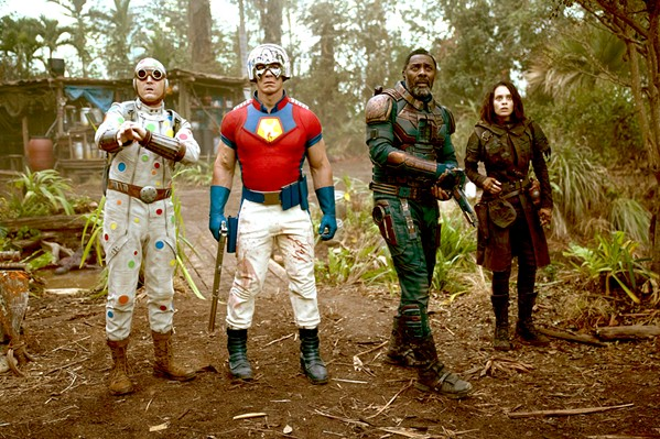 SUICIDAL A team of criminals—including (left to right) Polka Dot Man (David Dastmalchian), Peacemaker (John Cena), Bloodsport (Idris Elba), and Ratcatcher 2 (Daniela Melchior)—are recruited for an impossible mission, in The Suicide Squad. - PHOTO COURTESY OF ATLAS ENTERTAINMENT AND DC COMICS