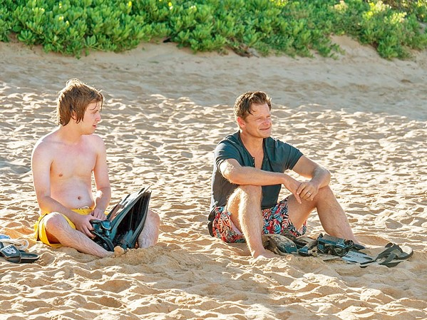TROUBLE IN PARADISE Son Quinn Mossbacher (Fred Hechinger, left) tries to connect to his dad, Mark (Steve Zahn), during an otherwise dysfunctional family vacation at an expensive Hawaiian resort, in HBO's miniseries The White Lotus. - PHOTO COURTESY OF RIP CORD PRODUCTIONS AND HBO