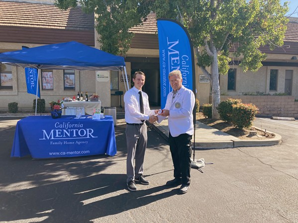 A NEW HOME California MENTOR Family Home Agency's ribbon cutting ceremony with Program Director Wesley Marking (left) and Santa Maria Chamber of Commerce Ambassador Paul Klock (right), marks the grand opening of the Santa Maria Office. - PHOTO COURTESY OF CAITY MCCARDELL