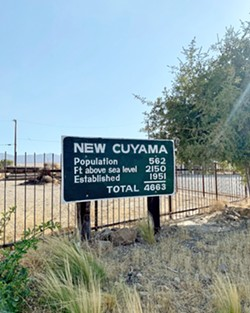 SMALL BUT MIGHTY New Cuyama has gained a hundred or so additional residents since this sign was made, but the point stands: This place is tiny. - PHOTO BY MALEA MARTIN