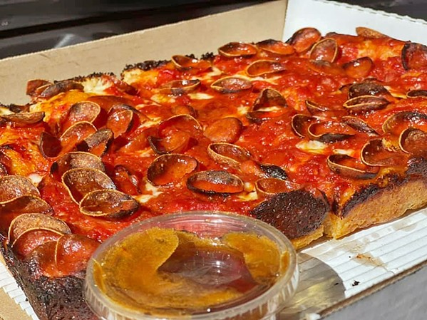 """PEPPERONI PLEASER A side of serrano- and habanero-infused hot honey at Benny's Pizza runs $2 for a 3-ounce ramekin. """"Although I would love to give it away, honey is expensive AF,"""" the eatery recently posted on Facebook. """"Trust me, you'll love it."""" - PHOTO COURTESY OF BENNY'S PIZZA"""