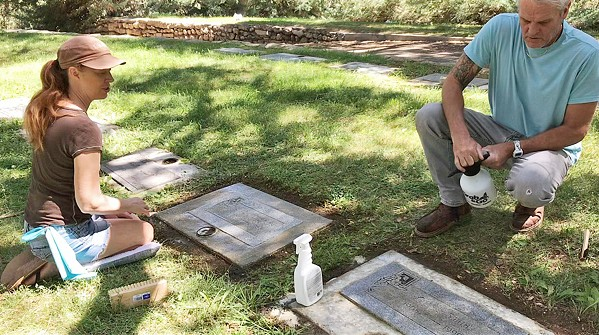CLEANING WITH MEANING Loshel and Lisa Robinson have been maintaining graves since July; but they've been together for 11 years and married since 2015. - COURTESY PHOTO OF LISA ROBINSON