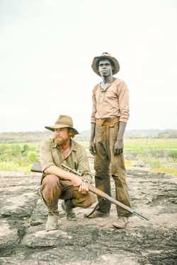 MORAL QUANDARY Travis (Simon Baker, left) and Gutjuk (Jacob Junior Nayinggul) team up to hunt down Gutjuk's uncle, who's leading a mob that's attacking white settlements in early 1930s Australian outback, in High Ground, screening on Hulu. - PHOTO COURTESY OF MAXO, BUNYA PRODUCTIUONS, AND SAVAGE