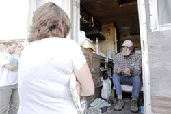 OUTSIDE LOOKING IN :  A county code official informs Sunny Acres resident Peter Ray he'll have to prepare to leave his trailer. - PHOTO BY STEVE E. MILLER