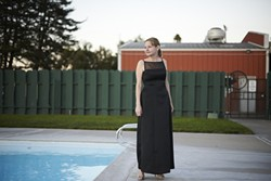 CLASSY :  Margaret Shepard Rousset shows off her dress around the Elks Lodge pool. - PHOTO BY STEVE E. MILLER