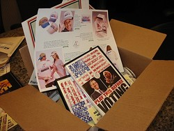 A BOX OF OBAMA :  On TwoVoters.com, people can buy a box of campaign materials featuring buttons, tickets, and posters. - PHOTO BY PATRICK HOWE