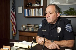 'UH OH' :  A driveway full of mulch prompted Arroyo Grande Police Chief Steve Annibali to park on the street, where a thief smashed his car window and stole a pouch holding the chief's gun and badge. - FILE PHOTO BY STEVE E. MILLER