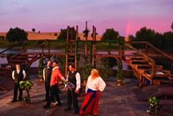 SHAKESPEARE AT TWILIGHT:  Charles Hayek, Corey Schonauer, Sean Peters, Matthew Hanson, and Krystal Kirk (left to right) rehearse Love's Labour's Lost as the sun sets on the River Oaks Amphitheatre, the outdoor stage at Paso's River Oaks Hot Springs. - PHOTO BY STEVE E. MILLER