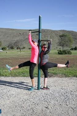 LEGS LIFTS?:  UGH! Kristen Meisenheimer (left) and Anna Starkey feel the burn. - PHOTO BY GLEN STARKEY