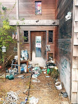 VANDALIZED AND CONDEMNED:  An abandoned Los Osos house vandalized with spray-painted swastikas was condemned by SLO Planning and Building on Sept. 28. - PHOTO BY PETER JOHNSON